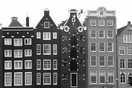 citytrip: Old canal houses in Amsterdam in black and white Stock Photo