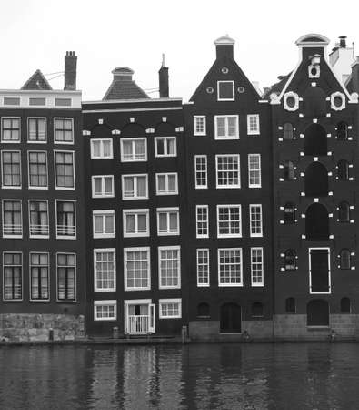 citytrip: Old canal houses along the Canal in black and white Stock Photo