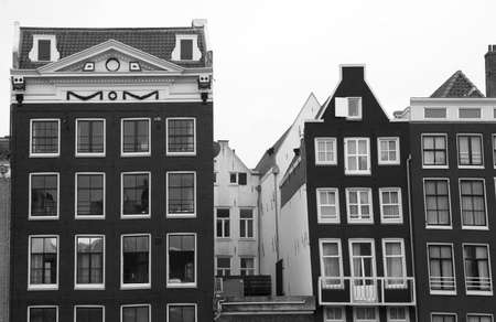 Sagging old canal houses in Amsterdam in balck and white