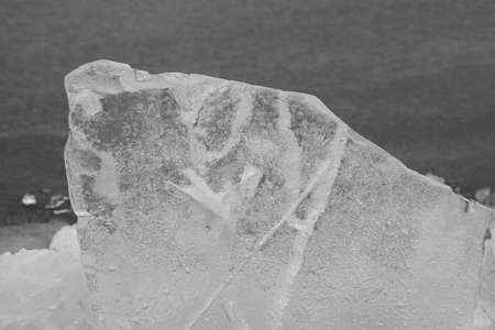 markermeer: A huge ice block in drifting ice black and white