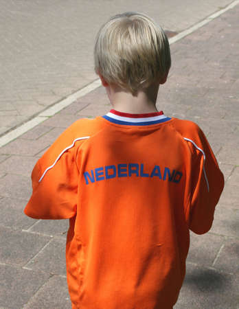 Young Dutch soccer fan in orange suit is ready for the European championship football