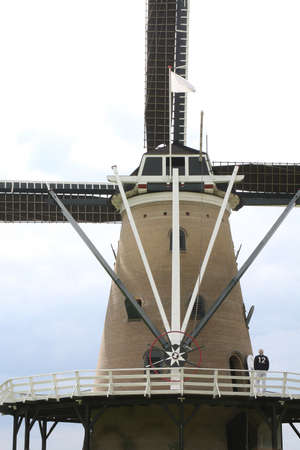A man is visiting a Dutch windmill during the National Windmill Day  admission is free photo