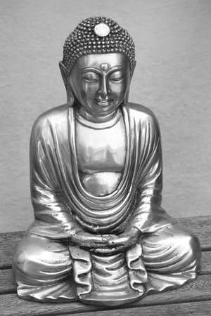 silver plated: Statue of a silver buddha in black and white  vintage