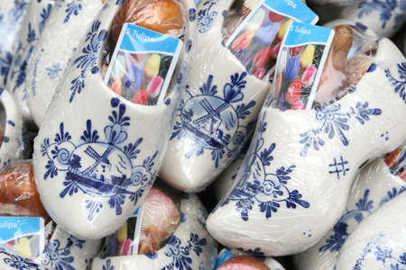 klompen: Wooden shoes and tulip bulbs from Holland Stock Photo