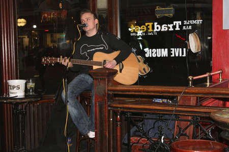 Performance by a singer in an Irish pub (Dublin) Editorial
