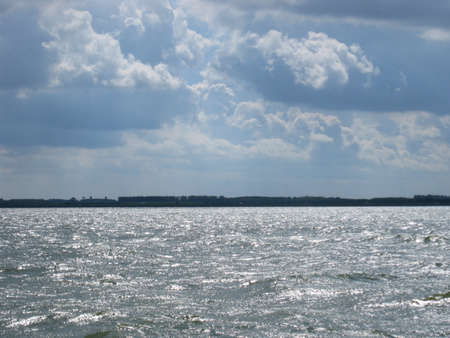 Thunderstorm is coming above a lake (IJsselmeer)  in Holland