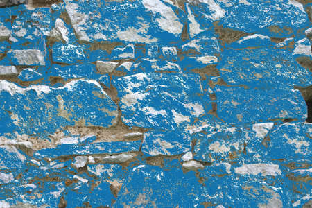 Blue painted wall of medieval stones