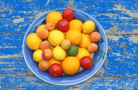 Fruit bowl at on old weathered table Stock Photo
