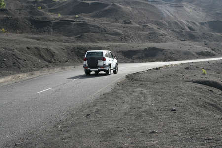 A car is driving the Route of the Volcanoes at La Palma photo