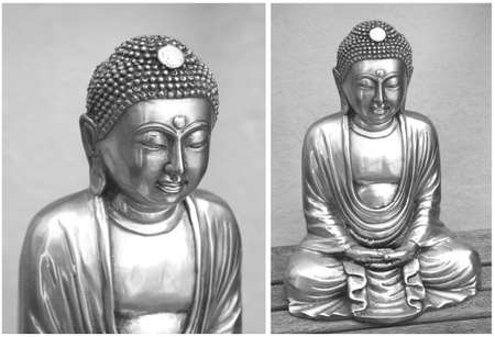 A couple of silver buddha statues Stock Photo
