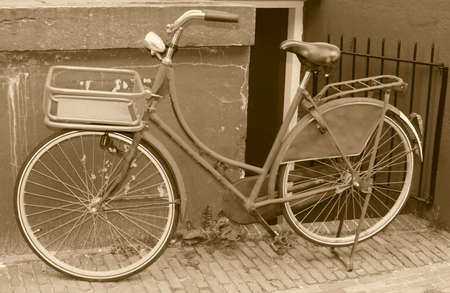 Old bike in sepia photo