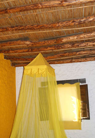 Room with a mosquito net against malaria Stock Photo