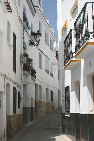 Street with white houses in a Spanish village Stock Photo - 15539775