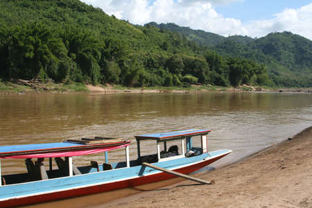ou: Traditional wooden boat at the Nam Ou river
