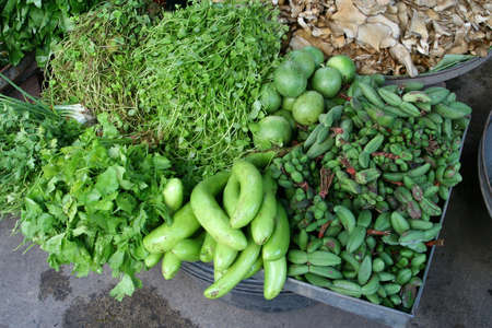 Fresh vegetables and herbs at the market Stock Photo