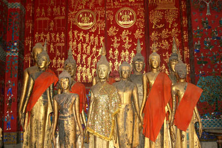 Antique Buddha statues in Wat Xieng Thong in Luang Prabang Stock Photo - 16282284
