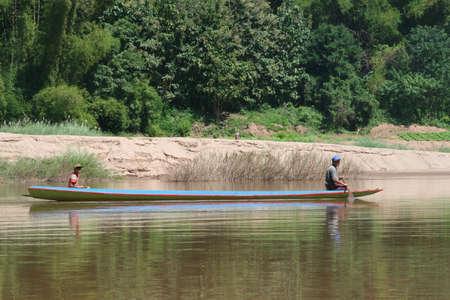 ou: Canoe at the Nam Ou river near Nong Kiaw in Laos