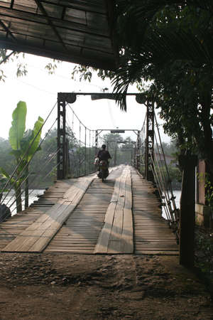 Wooden bridge in Vang Vieng Laos photo