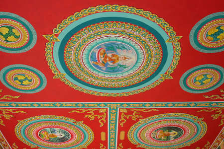 vientiane: Paintings in a Buddhist temple in Laos Stock Photo