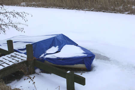 cane collar: Boat in a frozen canal in Holland