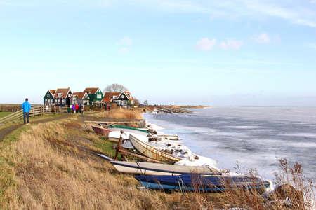 Village Marken along a frozen IJsselmeer near Amsterdam