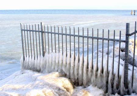ijsselmeer: Structure of a fence, snow and ice along a frozen IJsselmeer Stock Photo