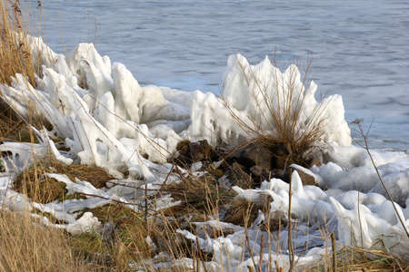 cane plumes: Artwork of snow and ice along the IJsselmeer in Holland Stock Photo