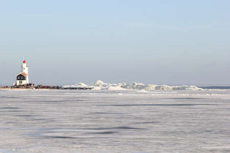 drifting ice: Lighthouse of Marken in the IJsselmeer and drifting ice