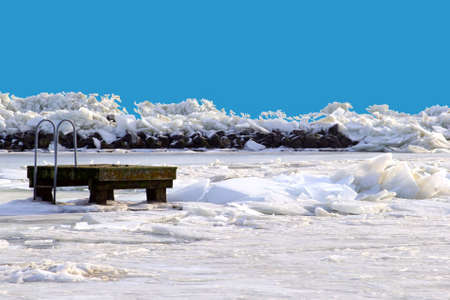 Pier in a frozen IJsselmeer near Amsterdam in Holland Stock Photo - 17687932