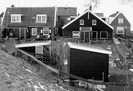Traditional old wooden houses in the village Marken near Amsterdam Stock Photo - 17838521