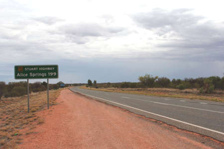 Road sign to Alice Springs along the Stuart Highway in Australia