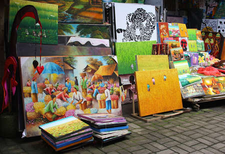 Paintings for sale at the market in Ubud