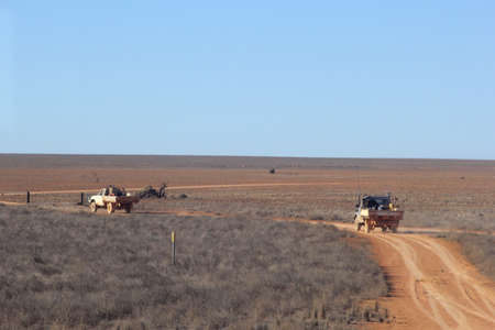 Two oldtimers are driving at the Nullarbor Plain in Australia photo
