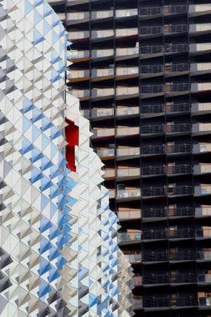 ventures: Contrast between a scyscraper with an artistic modern design and a scyscraper in black in Melbourne