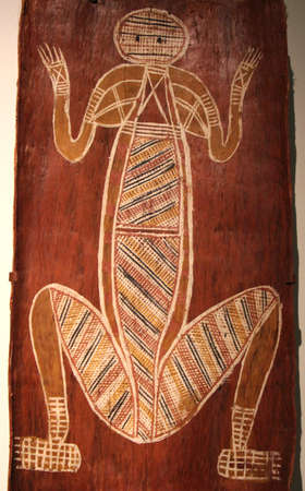 Primitive Aboriginal art at a wooden background in the South Australian Museum in Adelaide on 30 march 2013