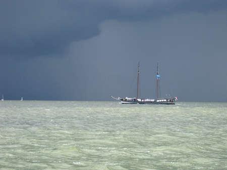 ijsselmeer: A thunderstorm is hanging above the IJsselmeer in the Netherlands Stock Photo