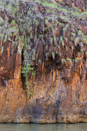 katherine: Background colorful rock wall along the river in Katherine Gorge in Northern Territory Australia