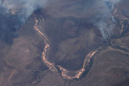 fire damage: Aerial photograph of the clouds of smoke from the forest fires in the Australian Outback in Northern Territory Stock Photo