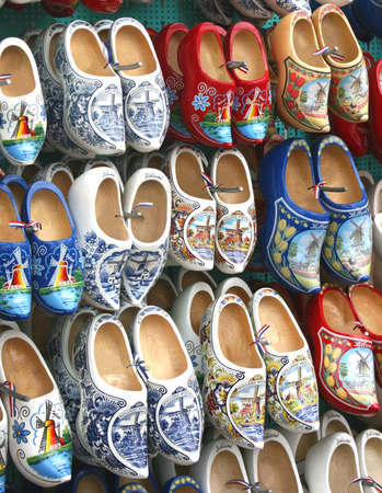 klompen: Wooden hand painted shoes for sale at the flower-market in Amsterdam Netherlands