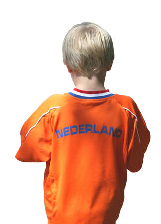 Young Dutch boy wears a shirt in the Dutch national colors and is isolated on white photo