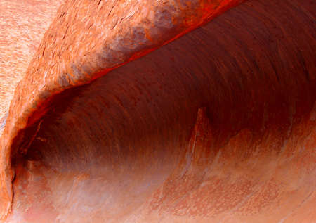 permanence: Background a cave which looks like a wave in the Olgas Kata Tjuta in the Northern Territory  of Australia