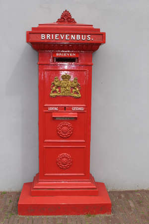 Amsterdam, Netherlands, july 1, 2013 Vintage red mailbox in the Netherlands