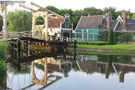 zaanse: Zaanse Schans with a traditional draw-bridge and vintage wooden houses Stock Photo