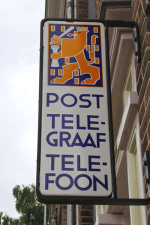 Netherlands, july 1, 2013 Vintage shield with advertisement for mail, telegraph and telephone