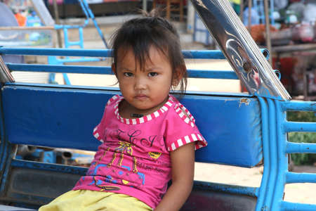 Lao Peoples Democratic Republic, october 27, 2012 Portrait of a young Laotian girl in a tuktuk in close up