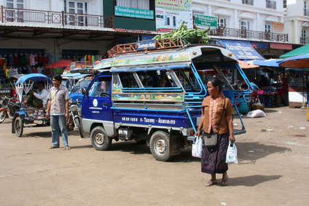 Lao Peoples Democratic Republic, october 28, 2012 Street life with a woman, tuktuk and a taxidriver in Laos