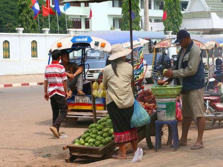 tuktuk: Vientiane, Lao Peoples Democratic, Republic, october 21, 2012 Street life of men and woman and tuktuk in Vientiane Editorial