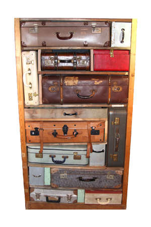 Collage with vintage leather suitcase in an old cabinet isolated on white photo