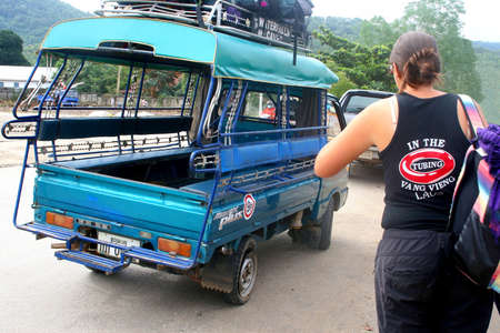 Lao Peoples Democratic Republic, october 18, 2012 Backpacker goes to travel with a tuktuk taxi
