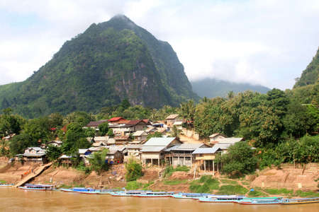 Village Nong Khiaw along the Nam Ou river in Laos  photo
